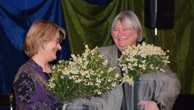 Head of School Josie Holford and Sylvia Buccelli, on behalf of previous head Anthony Buccelli, receive gifts honoring their hard work and vision.